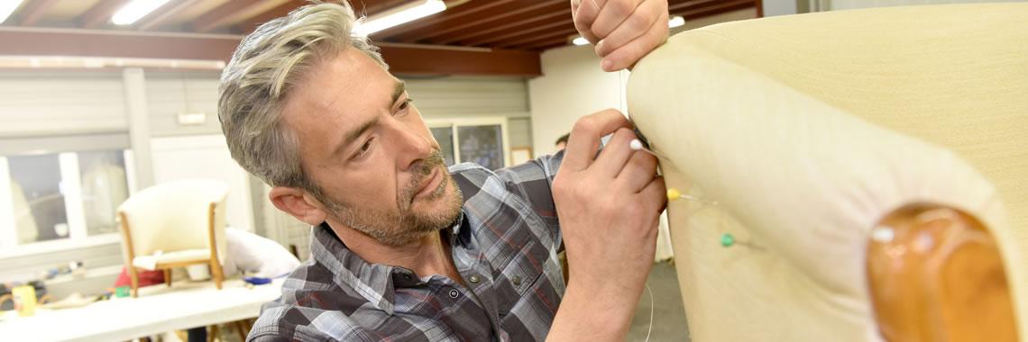 Upholsterer working on commercial furniture, Grand Rapids, MI